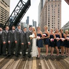 Different style navy blue short bridesmaid dresses with dark grey tuxes on the groomsmen