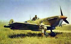 SAAF Spitfire V in Tunisea 1943.  A 40 Sqn. pilot confers with his no 2 at Gabes, Tunisia in April 1943.