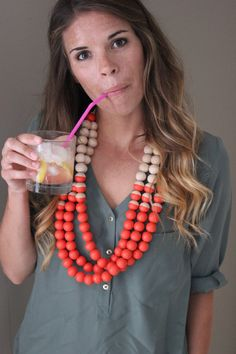 What fun! Should be easy to create a look like this, although I'd need to find a wholesaler to be able to afford that many big beads. Bright Poppy Red Wood Statement Necklace by TheBirdsWordBoutique, $55.00
