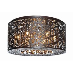 Provide a distinctive crowning touch to your room with this striking ceiling fixture featuring crystals and Xenon bulbs gleaming through a laser-cut drum shade. The flush-mount design yields dramatic impact in a low-profile silhouette.
