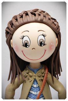 Fofucha niña con vestido, chaqueta, bolsito y su peinado con trenza. Todo es totalmente personalizado y hecho en goma eva.  www.xeitosas.com