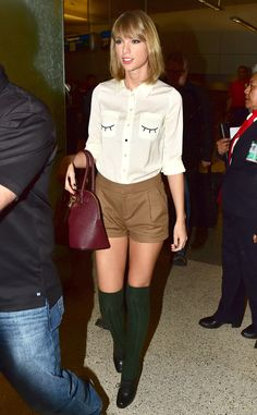 Taylor Swift's green knee socks paired with an adorable shirt and khaki shorts are too cute!