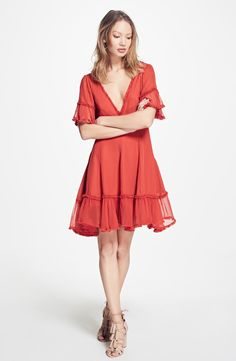 Free shipping and returns on Cinq à Sept Dianne Ruffle Silk Fit & Flare Dress at Nordstrom.com. Pre-order this style from the Spring 2017 collection! Limited quantities. Ships as soon as available. You'll be charged only when your item ships.Diaphanous fringe-trimmed ruffles flutter from the sleeves and hem of this cherry-red party dress cut from pure silk. A plunging neckline showcases the décolletage, and an Empire waist and gently curved princess seams sculpt a figure-flattering si...
