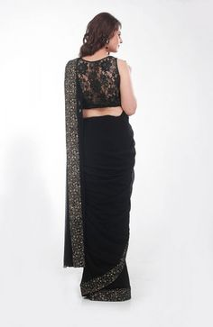 Black Mink Saree Preeti Singhal's Black Georgette Saree with a sequined border, comes with a mink and crystal studded Chantilly lace blouse