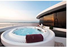 Take a relaxing spa bath whilst watching the world go by on superyacht South - Fraser Yachts
