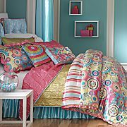 Neat color on the walls, and cool bedspread for a young girl.