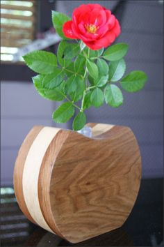 Wooden Bud Vase - This handcrafted wooden bud vase holds precious buds of your favorite flowers. Dress up the vase with a single flower for a beautiful display. Featuring a variety of hardwoods and shapes these bud vases will add the perfect finishing touch to any room in your home. The flower bud tube holds water and is inserted into the center of the wooden vase.  truly extra special gift for many occasions including Birthdays, Mother's Day, 5 Year Anniversary, or for yourself. Fresh…