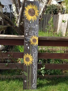 Repurposed wooden sunflower sign. Would be perfect for any entryway!