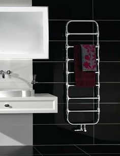 Zehnder Nobis and its high quality chrome finished tubes bring a special look to every bathroom. The large spacing between the tubes combines distinctive character with functionality. Several towels can be heated at the same time. Bath Towel Racks, Bathroom Towel Rails, Bathroom Storage, Mirror Radiator, Towel Radiator, Bookshelf Design, Bookcase Storage, Decorative Radiators, Chrome Towel Rail