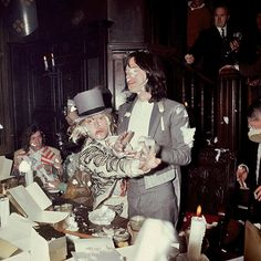 Brian Jones and Mick Jagger enjoy a food fight at the Kensington Gore Hotel, where the band staged a mock medieval banquet for the launch of Beggars Banquet on December 5th, 1968.