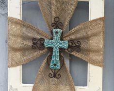Beautiful Rustic look with the Ceramic Cross and Burlap attached to a Re purposed Frame painted Antique White.  Frames are Re purposed, painted and Distressed. No 2 frames are alike. Sizes Range from 8x10 to 12x13 Sizes. If you are wanting larger please let me know before ordering.  «« Crosses Are available in Turquoise, Blue, White, Burgundy, Brown.«  ****THE FRAMES PICTURED ARE NOT THE ONES YOU WILL RECEIVE...****   I have Other Crosses and Frames available for sale. Can be customized to…
