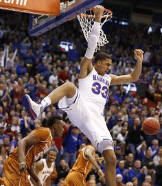 Kansas forward Landen Lucas (33) comes down from a dunk over Texas forward Myles Turner (52) during the first half on Saturday, Feb. 28, 2015 at Allen Fieldhouse.