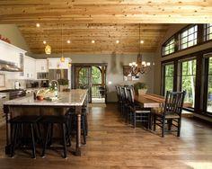 Red Leaves dining room. Cedar ceiling and dark wood floors. Dark wood windows with grills. http://www.linwoodhomes.com/house-plans/plans/red-leaves/