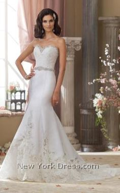Channel the glamor of the silver screen in this glimmering wedding gown by David Tutera 214208. Reflective crystals edge the strapless, sweetheart neckline with
