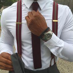 Burgundy knit tie and suspenders.