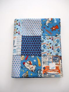 Minky baby boy patchwork sewn from Riley Blake's new line, Rocket Age. Very retro with loads of ideas to decorate a complete nursery. Backed with Shannon Fabrics' (the best made) navy blue Dimple Dot minky and interlined with Warm & Natural cotton batting, it's in my Etsy shop now!
