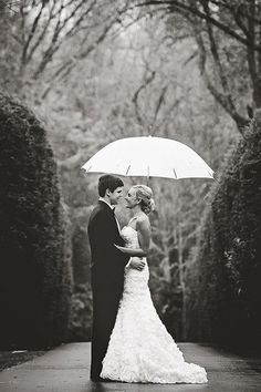 Beautiful rainy day photo of the bride and groom. Proof that you can get gorgeous wedding photos in any weather!