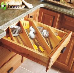 ...found this on www.houzz.com - don't know where to find the divider, but what a great idea for those extra long utensils!