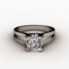 This is very different from other designs I've liked, but something draws me to this clean look! Radiant rectangular diamond instead of princess. /// Wide Split Shank Princess Cut Solitaire Engagement Ring. Highlighting its beauty, this gorgeous one of a kind diamond engagement ring features a split shank design.