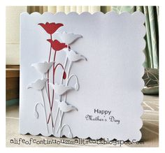 """By Annette. Use scallop punch on open edges of white card base. Die cut """"Prim Poppies"""" (Memory Box) from the card front. Add red cardstock to left inside of card. Die cut 3 more poppies from white cardstock. Arrange over the red ones, popping up the flower heads."""