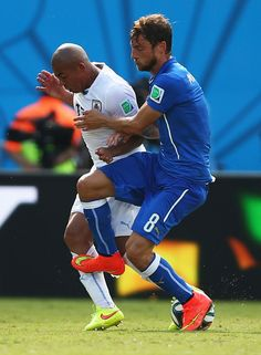 Claudio Marchisio of Italy fouls Egidio Arevalo Rios of Uruguay and is sent off during the 2014 FIFA World Cup Brazil Group D match between ...