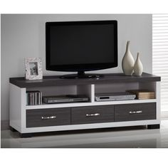 a tv stand with three drawers and open shelving space oxley tv unit is a