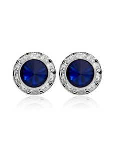 Brilliant blue button earring encircled with hand set faceted crystals for dazzling drama in simplistic elegance.