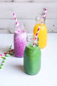 Three smoothies with berries,fruits and greens - stock photo