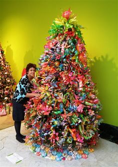 plastic bottle art Orlando Museum of Art submission by our school All grades worked to create this tree for the Festival of Trees. The tree skirt was made by the preSchool students and the topper made by the high school. It was a big hit. Recycled Christmas Tree, Xmas Tree, Christmas Crafts, Christmas Trees, Christmas Ornaments, Christmas Holidays, Plastic Bottle Crafts, Recycle Plastic Bottles, Plastic Art