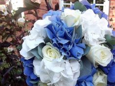 Blue and White Hydrangea along with white roses and eucalyptus