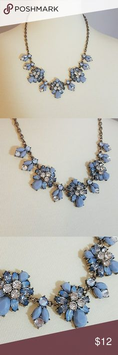 Statement Necklace Beautiful statement necklace with light blue opaque, light blue clear, and white clear gemstones. Metal is a brushed bronze. Lobster claw clasp with extender. Mixit Jewelry