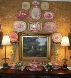 Red transferware plates & platters hanging on wall - red, cream and gold toile wallpaper - Nancy's Daily Dish