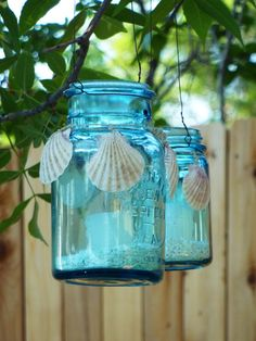 1- I found a box of these turquoise blue mason jars in our basement. I tied shells on the outside, poured crushed shells inside, and added a candle.
