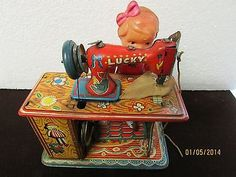 Vintage Tin Wind Up Girl with Lucky Sewing Machine Toy