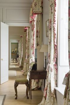 The ruffles are a little dated... but I love a hallway of curtains.