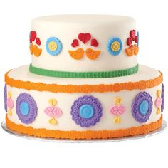 Create a folk art masterpiece cake using decorations made with Wilton's Folk Fondant and Gum Paste Mold. Perfect for so many celebrations, the bright and colorful decorations are easily made with Ready-To-Use Rolled Fondant.