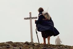 Picture of an Irish pilgrim woman walking barefoot to visit Croagh Patrick, a holy mountain in County Mayo.