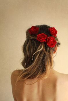 Red flowers in pinned up hair.