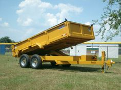 7 x 14 12k low profile dump trailer with tarp kit and heavy duty scissor lift. equipment ramps included