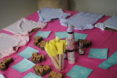 Onesie decorating station at a Baby Shower.