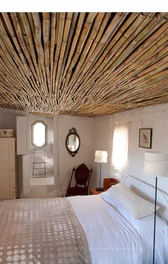 bamboo ceiling in cottage med bedroom via Adriaan Oosthuizen Fotografie Thinking of adding this in the bathroom ceiling