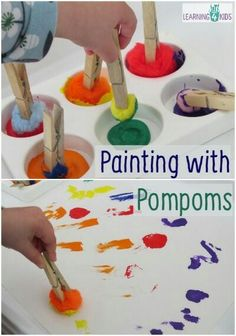 Painting with pompomps and clothespins.
