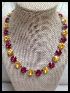 Red and gold team spirit necklace in Swarovski crystals Siam red and Sunflower yellow.