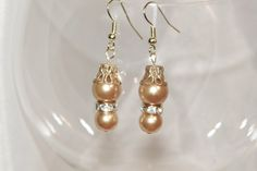 Gold tone pearl and crystal dangle earrings by TheEccentricBead