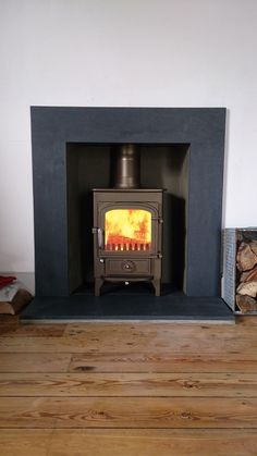 Clearview Pioneer complete with a honed slate surround, installed by Kernow Fire… – Freestanding fireplace wood burning Wood Burning Logs, Stove Installation, Home Panel, Freestanding Fireplace, Fire Surround, Stove Fireplace, Log Burner, Room Pictures, Brown Wood
