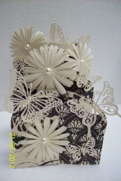 cascading card - love the flowers with the pearl in the middle