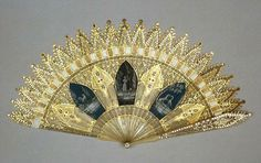 Brisé fan, French, c.1820, horn sticks and guards with ends shaped to resemble crocketed pinnacles, pierced, painted in bodycolour, gilt and set with cut steels. Fitzwilliams Museum.