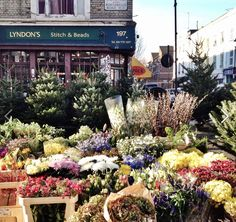 The local flower stall in front of Lyndon's Stitch and Beads on Portobello Road. Well priced. Get there before 11 a.m  on Saturday otherwise all the good stuff will be gone...