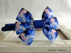 Tiara produzida com fita de gorgurão - Frozen.  Tamanho aproximado do laço: 9 x 7 cm.  Cor do centro do laço: azul royal.  Cor do arco: azul royal.