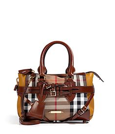Rich ochre leather sides lend a chic compliment to this house check handbag from Burberry London #Stylebop